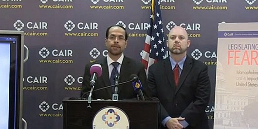 """CAIR's Executive Director and Founder Nihad Awad (L) and National Legislative Director Corey Saylor announcing the release of their agitprop report on """"Islamophobia,"""" whose aim was to shut down discussion on Islamism."""